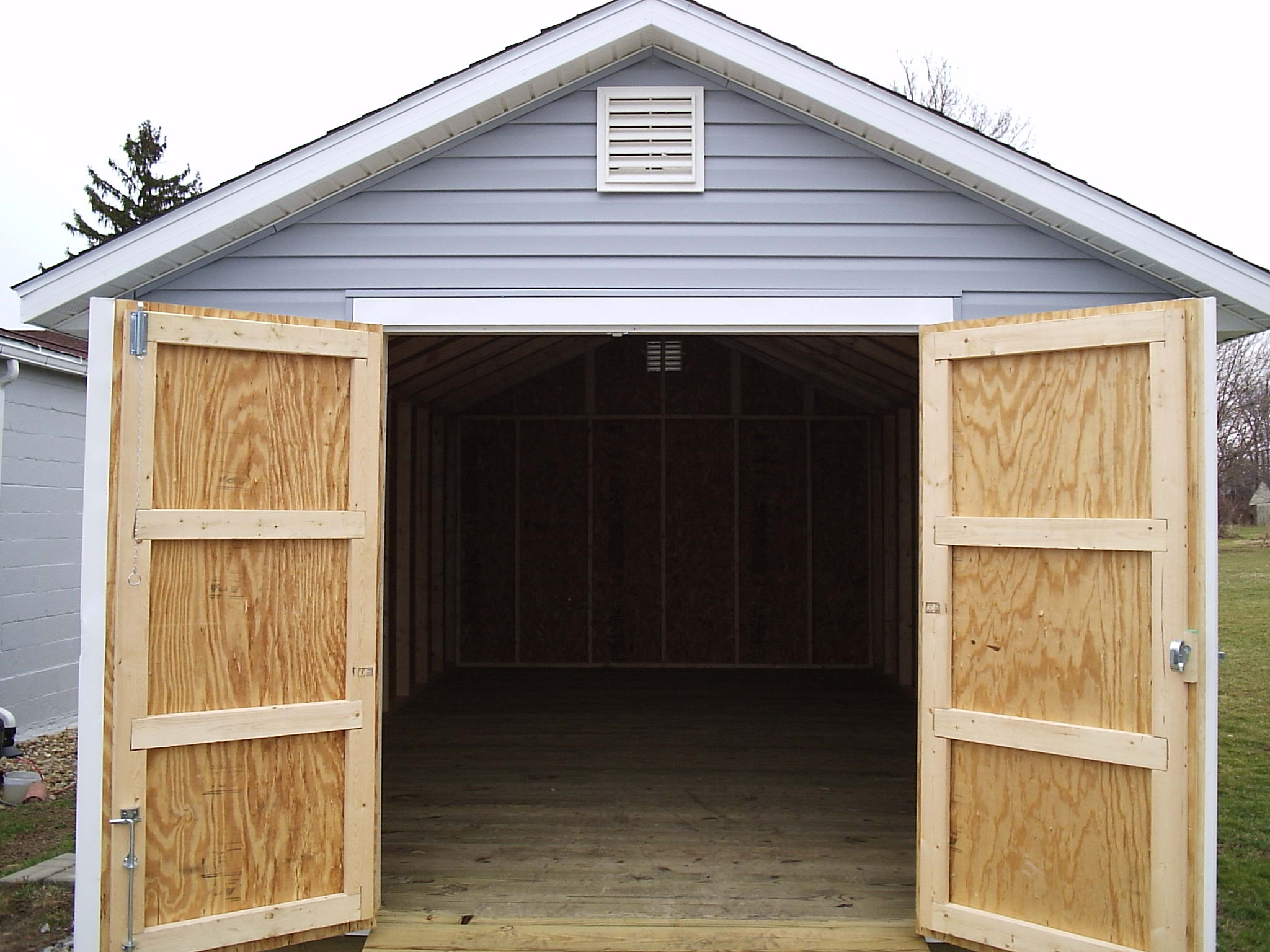 Storage shed door latches