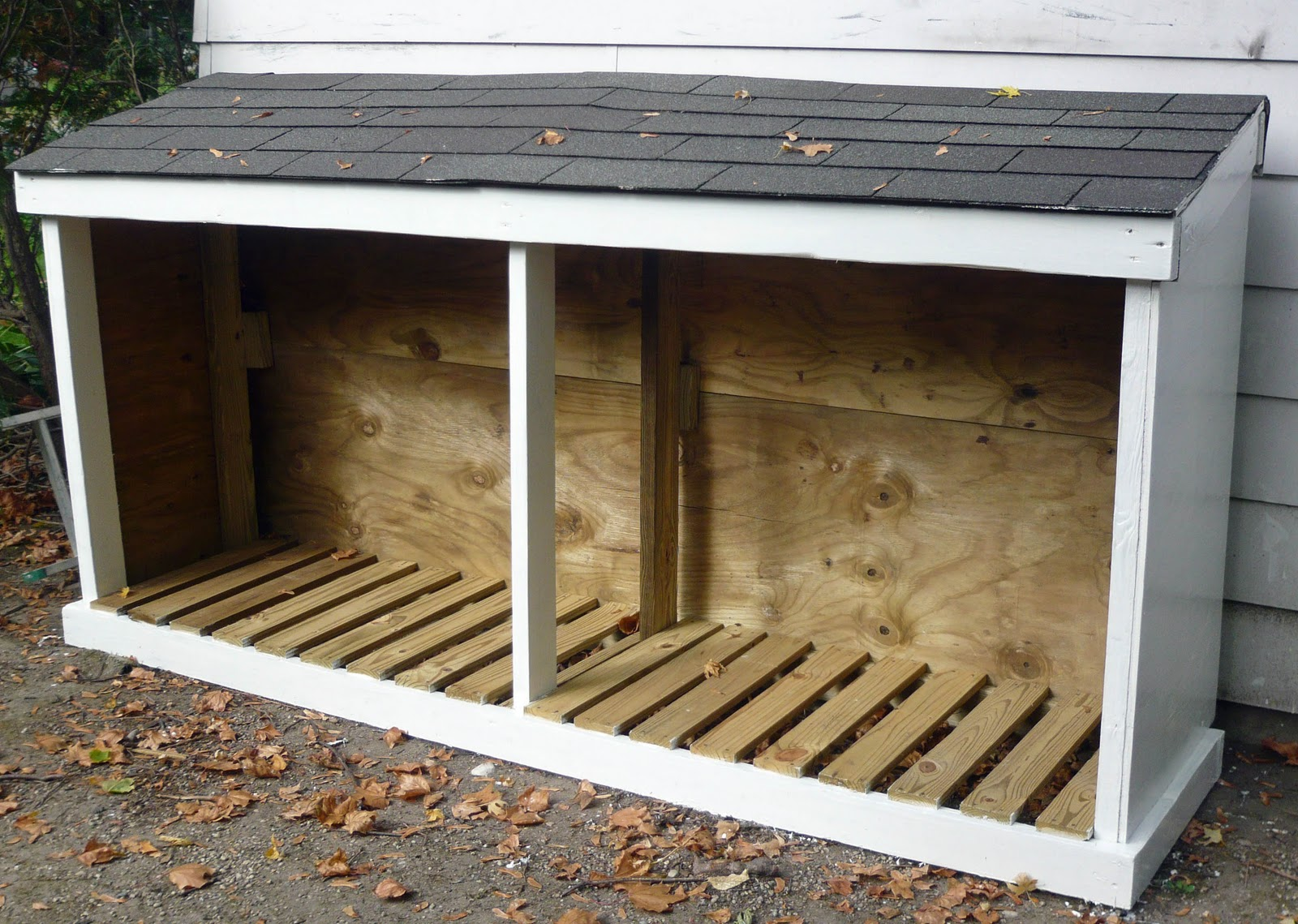 How to buy replacement wood shed doors for your back yard for Side of the house storage shed
